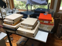 boxes of prints in studio